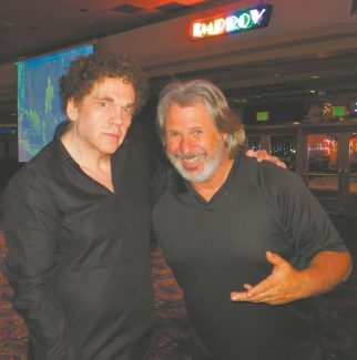 Back in black at Harveys Resort and Casino are Charles Fleischer, left, who is influenced by doctors of science, and Improv host Howie Nave, whose big break came from Dr. Demento.