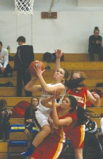 Becky Regan / Tahoe Daily Tribune Ally King drives toward the hoop in the Vikings' 49-24 win over Whittell at South Tahoe High School on Saturday.