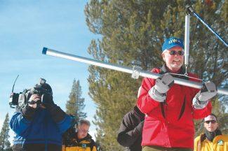 Axie Navas / Tahoe Daily TribuneSurrounded by media from various outlets, Frank Gehrke measures the snowpack water content at Phillips Station Tuesday.