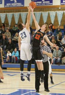 Sylas Wright / Sierra SunAustin Neil goes for the jump ball at North Tahoe on Friday. The boys won 49-47.