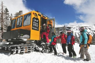 A group of skiers and snowboarders load into a snow cat to go cat skiing at Kirkwood Mountain Resort near South Lake Tahoe, California.