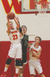 Boyd Dangtongdee / Special to the Tribune Garrett Bronken pulls a rebound away from Incline while Bryce Bronken lends support Tuesday at Whittell High School.