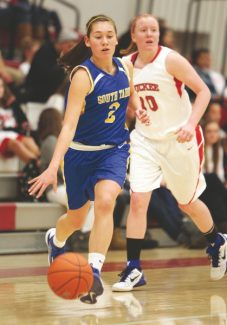 Sylas Wright / Sierra Sun Brooke King drives past Truckee during the girls' away game Tuesday.