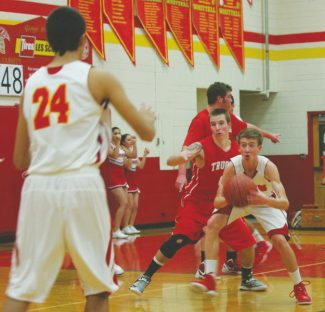Boyd Dangtongdee / Special to the Tribune Palmer Chaplin holds it down against Truckee on Tuesday at Whittell High School. Chaplin had a 25-point game that included a game-winning shot in overtime.