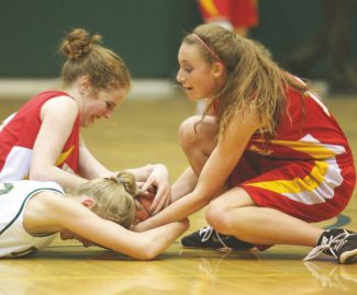 Sylas Wright / Sierra Sun Amanda Harris, left, and Sierra Forvilly, right, go for the ball during Whittell's game at Incline on Tuesday.