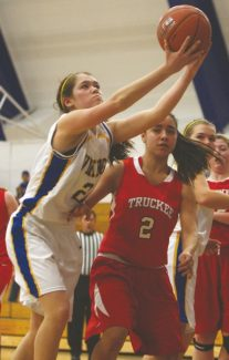 Becky Regan / Tahoe Daily TribuneAlly King stretches past Truckee for the rebound in South Tahoe's home game Tuesday. The Vikings won 41-40.