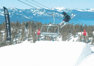 Axie Navas/Tahoe Daily TribuneA skier gets air Thursday in Heavenly's High Roller terrain park. If the Winter X Games come to Lake Tahoe, the competitions would be split between Heavenly Ski Resort and Squaw Valley.