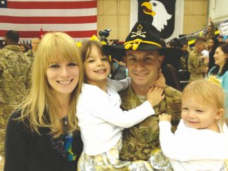 Provided to the TribuneChristina and Greg Northrup pose for the camera with their two girls Wednesday shortly after Greg Northrup returned from a six-month tour in  Afghanistan.