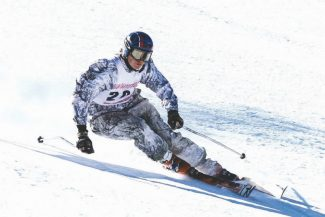 Boyd Dangtongdee / Special to the TribuneWhittell's Hughston Norton led the South Shore boys after day one of racing with a time of 2:14.5, landing him in second. Norton drove with three other skiers through the night from a Far West competition to make Monday's race.