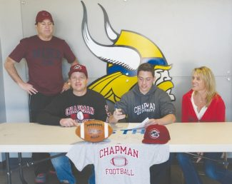 Becky Regan / Tahoe Daily Tribune South Tahoe quarterback John Cefalu committed to Chapman University this week. Cefalu's 4.5 GPA and 2060 SAT score earned him academic scholarships that add up to a full-ride. Left to right: South Tahoe head football coach Kevin Hennessee, Joby Cefalu, John Cefalu and Laura Cefalu.