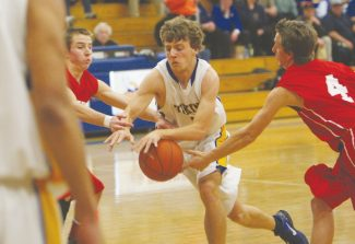 Becky Regan / Tahoe Daily Tribune  Brandon Cramer drives past Truckee during South Tahoe's home win Feb. 5. Cramer drained a game-high 19 points during the game, with two 3 pointers. His standout sesaon performance earned him a spot on All-League first team.