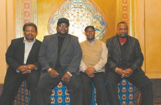 """Photo by Brad Gregory The Slide Brothers are, from left, Aubrey Ghant, Darick Campbell, Calvin Cooke, Chuck Campbell. It's debut album, """"80 years in the making,"""" came out Tuesday."""