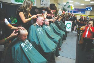 Axie Navas / Tahoe Daily TribuneMen and women shaved their heads Friday night for the second South Shore St. Baldrick's event to raise money for childhood cancer research.