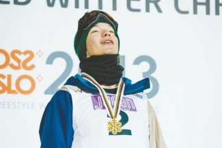 Gold medalist David Wise, of the US on the podium, after the men's Ski Halfpipe event at the FIS Freestyle World Ski Championships in Oslo, Tuesday, March 5, 2013. (AP Photo/NTB Scanpix, Stian Lysberg Solum)  NORWAY OUT