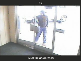 South Lake Tahoe Police DepartmentThis image taken from video surveillance footage shows the suspect in an alleged robbery that took place Thursday at El Dorado Savings Bank at 3443 Lake Tahoe Boulevard.