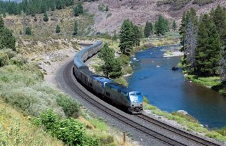 This undated image provided by Amtrak shows the California Zephyr train near Truckee, Calif. The California Zephyr starts in Emeryville, Calif., near San Francisco, en route to Reno, Nev., a 236-mile journey that offers beautiful views as well as history. It crosses the Sierra Nevada mountain range and follows the same course as the historic Transcontinental Railroad, a 19th century engineering feat that bolstered the nation's western expansion. The Zephyr's ultimate destination is Chicago, a 51-hour trip from Emeryville. (AP Photo/Amtrak, Phil Gosney)