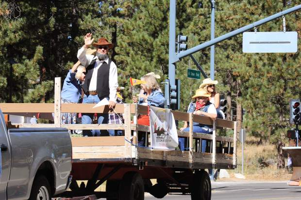 A parade participant waves to the crowd during the City of South Lake Tahoe's 50th anniversary parade.