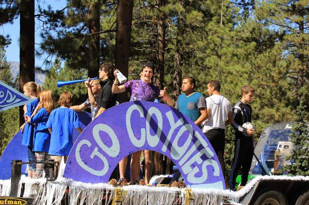 Lake Tahoe Community College members wave to the crowd during the 50th anniversary parade, Saturday, Sept. 19.