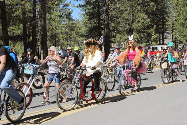 Costumed bike riders cycle down Al Tahoe Boulevard celebrating South Lake Tahoe's 50th anniversary during the city's parade, Saturday, Sept. 19.