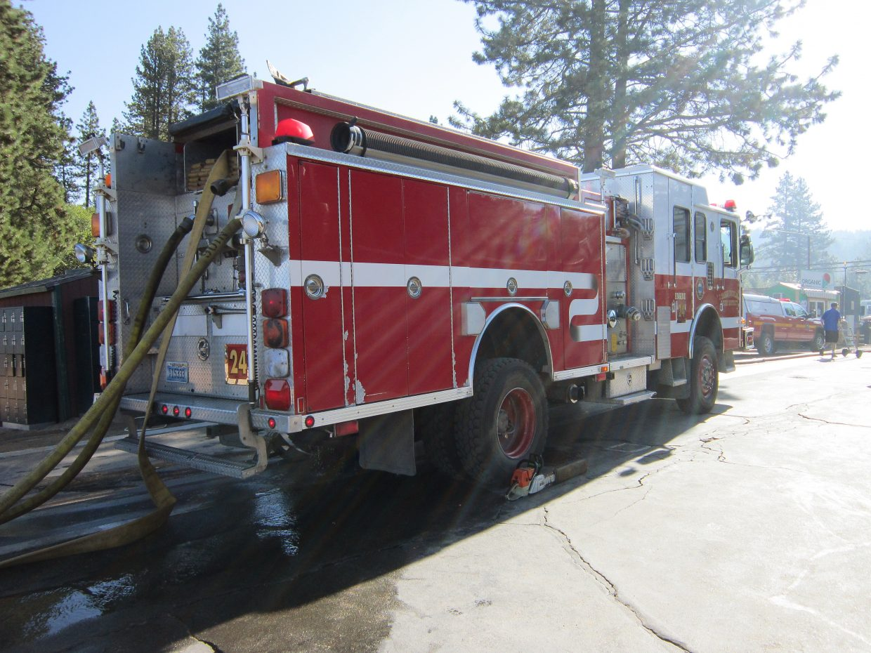 Douglas County Fire Department and police were on site at Zephyr Cove Marina, where fire on the Tahoe Queen broke out Tuesday morning, Aug. 16.