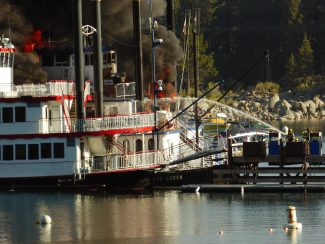 Tahoe Douglas Fire fights the flames engulfing the Tahoe Queen on the morning of Tuesday, Aug. 16, in Zephyr Cove.