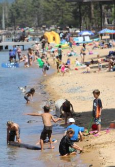 Beach-goers escape possibly record-breaking heat at Camp Richardson Thursday afternoon. Adam Jensen / Tahoe Daily Tribune