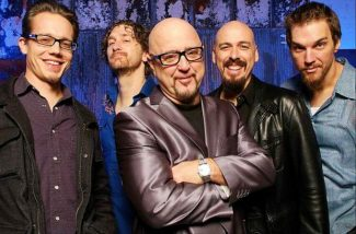 Jay Moeller, Johnny Moeller, Mike Keller and Randy Bermudes join band co-founder Kim Wilson (the sole original member), middle, for the modern version of The Fabulous Thunderbirds.
