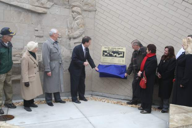 Lt. Gov. Brian Krolicki, left, and Tom Stephens unveil a new plaque at the Veterans Memorial on Monday.