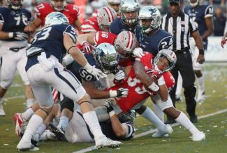 UNLV's Tim Cornett (35) scores against Nevada during the second half of an NCAA college football game in Reno, Nev., on Saturda.