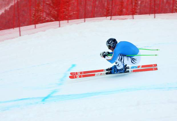 A German national team racer tucks low during a training run at the early-season downhill course on Copper Mountain. The resort is a hub of ski team training in November before the World Cup season begins.