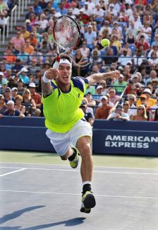 Leonardo Mayer of Argentina returns a shot against Andy Murray of Great Britain during the second round of the 2013 U.S. Open tennis tournament, Friday, Aug. 30, 2013, in New York. (AP Photo/Mike Groll)
