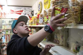 South Lake Tahoe resident Irvin Herrera, 15, works at Plaza Tapatia on Monday to build school credit, gain work experience and stay out of trouble.