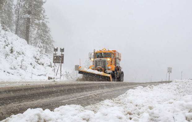 A snowplow crests over Daggett Pass on Kingsbury Grade / State Route 207 near South Lake Tahoe, California, during the first winter storm of the season to hit the Sierra Nevada region, Monday, Nov. 2.