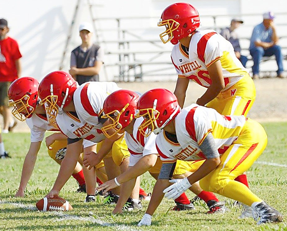 Womack gets ready for a snap behind Whittell's offensive line Saturday.