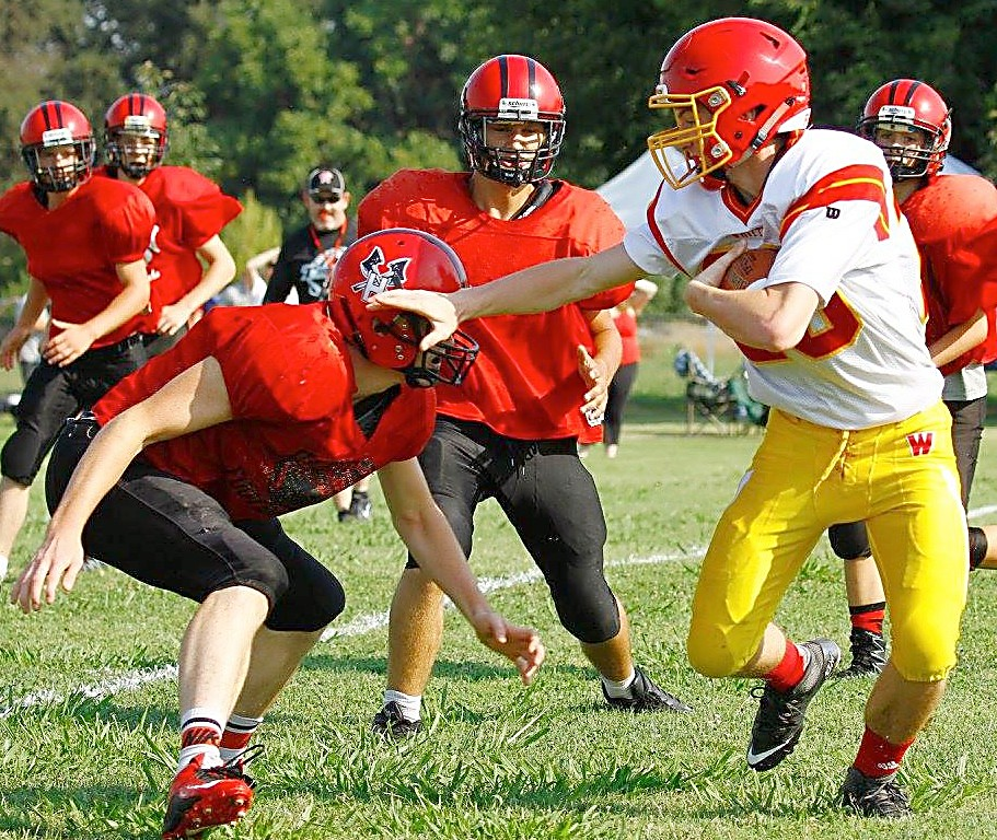 Whittell junior Caleb Moretti stiff-arms a Hayfork defender during the Warriors' scrimmage at Princeton High on Saturday, Aug. 20.