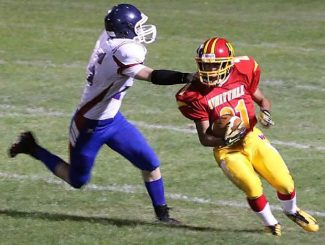 Whittell running back Max Primo makes a Loyalton defender miss in the Warriors' season-opening 50-36 win Friday.