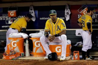Oakland Athletics center fielder Chris Young sits on a gatorade cooler after the Oakland Athletics lost 3-0 to the Detroit Tigers in Game 5 of an American League baseball division series in Oakland, Calif., Thursday.