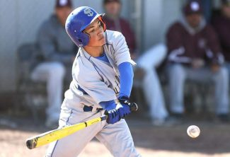 South Tahoe's Aaron Pfister hits a single to drive in a run against Dayton on Tuesday.
