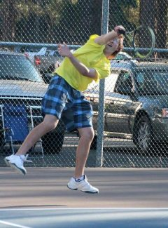 No. 1 doubles player Colton McHugh slams the ball over the net as South Tahoe hosts Wooster High School on Tuesday.