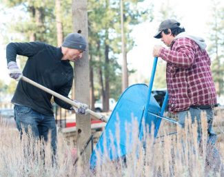 Tyler Cannon, left, and Eric Valenzuela install signs for the Nordic Ski Center at Lake Tahoe Community College last week.