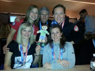 LTEC's vice president and co-founder Larry Sidney with the US Women's Olympic curling team, and Flat Stanley, in Soch. Shown are Jessica Schultz, from back row left, Larry Sidney, Ann Swisshelm