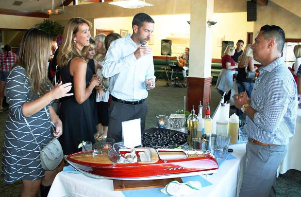 "Riva Grill's Erick Martinez, far right, received ""Best Cocktail"" and ""Most Congenial Bartender."""
