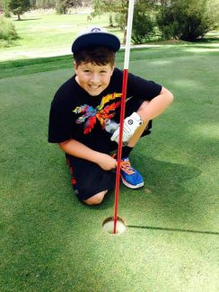Jayson Wallom, 10, hit a hole-in-one at hole 5 at Tahoe Paradise Golf Course on Saturday.