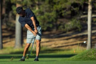 Kelly Slater hammers one off the fairway at Edgewood during the American Century Celebrity Golf Tournament Thursday evening.