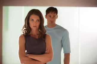"""This image released by The Weinstein Company shows Katie Holmes, left, and Alexander Skarsgard in a scene from """"The Giver."""""""