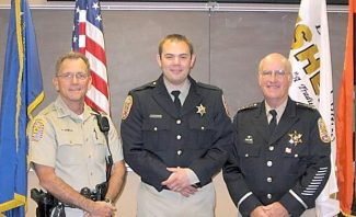 Undersheriff Paul Howell, left, and Sheriff Ron Pierini welcome Douglas County's newest deputy, Michael Barden. Barden, 28, was sworn in Monday at the Valley station.