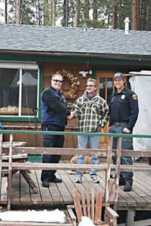 Lake Valley Fire Chief Gareth Harris, left, and grant manager Martin Goldberg, right, pictured with Black Bart homeowner David Klecker. Klecker is the first homeowner to replace his roof through the Hazardous Wood Roof Replacement Program in 2014.