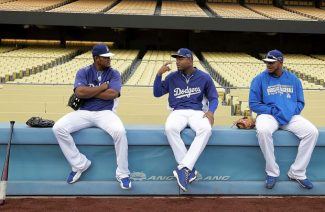 From left to right: The Dodgers' Juan Uribe, Carl Crawford and Kenley Jansen talk during Wednesday's practice in preparation for today's Game 1 of the National League baseball championship series. The Dodgers will face the Cardinals in St. Louis.
