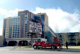 Work takes place at the Park Tahoe Casino Resort sign at Stateline. The casino changed its name from The Horizon Casino Resort to Park Tahoe this week.