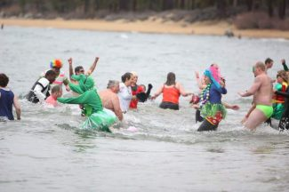 Participants run into Lake Tahoe during the Polar Plunge in Zephyr Cove on Saturday. The Polar Plunger is held each year to raise money for Special Olympics Northern California and Special Olympics Nevada.